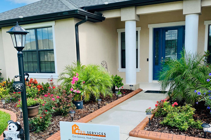 Pro Services Contractors tan house before 1